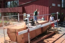 Portable sawmilling large Redwood log with a Peterson All Terrain Sawmill