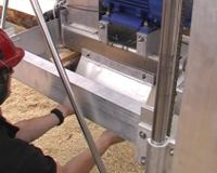 Remove the sawdust deflector with two simple screws.