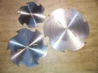 Different sized circular blades for Peterson Portable Sawmill.