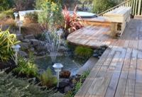 The finished deck and fishpond at Aria's Farm