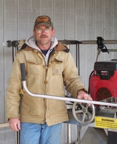 Dave McElwain and his Peterson WPF Sawmill.