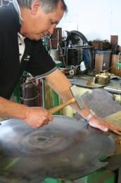 Hammer tensioning of the swingmill blade.