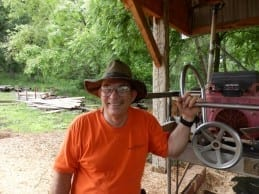 Russ Wilkins, of Wilkins Tree Farm, with his Peterson Sawmill.