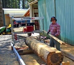 Ted Issacs with his small sawmill, the Junior Peterson