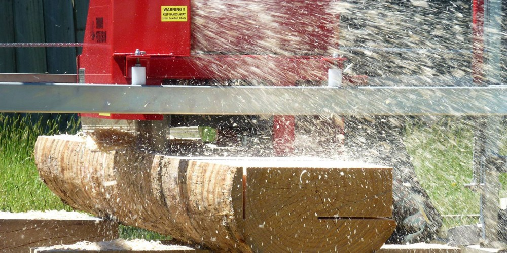 Junior Peterson Sawmill double cutting a wide board from a log
