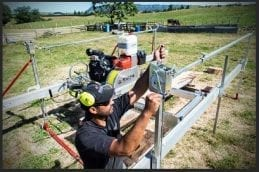 Making manual winch adjustments on Peterson custom-order portable sawmill