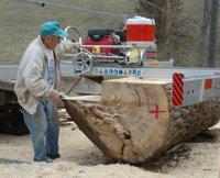 Wilbert Schuldt operating his sawmill, the All Terrain Sawmill
