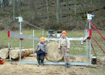 Scot Postle 's two boys with his Peterson Sawmill.