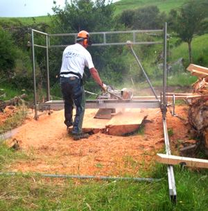 Ian Abraham milling Macrocarpa with his Peterson Sawmill.