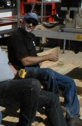 Craig Blake sitting with his Peterson Sawmill.