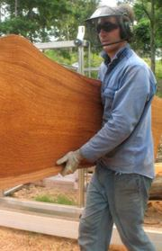 Owen Burns with slab from DWS sawmill.