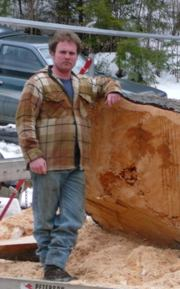 Chad Burrell with his Peterson Sawmill.