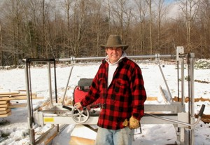 Karl Christensen with his Peterson Sawmill in the snow.