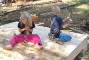 Nathan Dearyan's children playing with the woodworking tools.