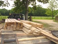Stacks of lumber cut with Jimmy Edwards's Peterson Sawmill.