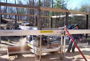 Jerome Lauzon running his Peterson Sawmill.