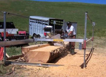 Mike Pezzoli milling pine with his Peterson Sawmill.