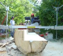 Paul Van Steenberghe milling dimensional lumber with his Peterson Sawmill.