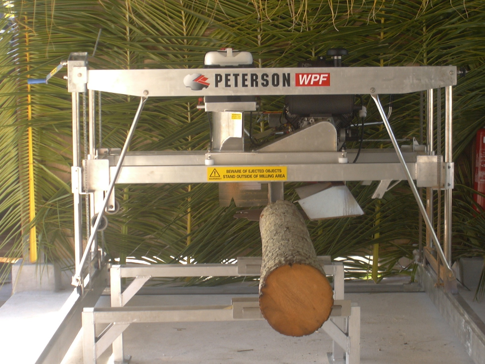 Used Portable Sawmills For Sale >> Cutting coconut timber with a Peterson Sawmill