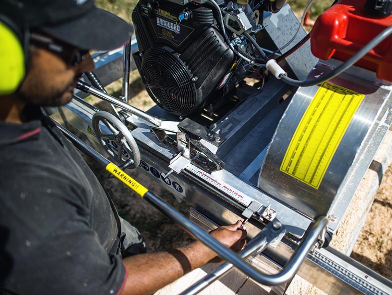 Aaron Kalan making horizontal blade adjustments on the Peterson quality portable sawmill