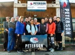 Peterson staff standing in front of Peterson Headquarters in Rotorua, where their high quality portable sawmill is made.